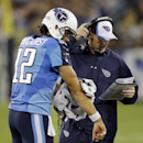 Tennessee Titans quarterback Charlie Whitehurst (12) towels off from the rain as he talks with head coach Ken Whisenhunt in the second quarter of a preseason NFL football game against the Green Bay Packers, Saturday, Aug. 9, 2014, in Nashville, Tenn The A