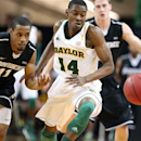 Baylor's Deuce Bello (14), right, and Providence's Bryce Cotton (11), left, watch a loose ball during the first half of an NIT college basketball game in Waco, Texas, Wednesday, March 27, 2013. (AP Photo/Waco Tribune Herald, Rod Aydelotte)