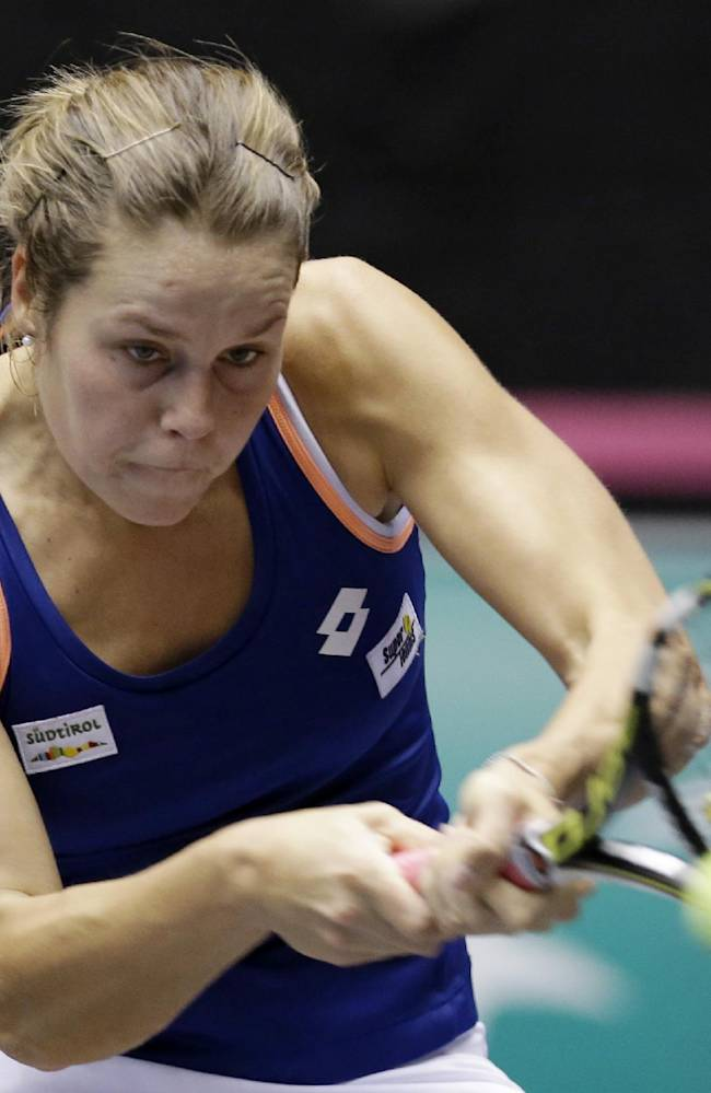 Italy's Karin Knapp returns the ball to United States Christina McHale during a Fed Cup world group tennis match Saturday, Feb. 8, 2014, in Cleveland