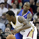 Los Angeles Clippers guard Jamal Crawford (11) tries to kick the ball away from New Orleans Pelicans forward Al-Farouq Aminu (0) in the first half of an NBA basketball in New Orleans, Monday, Feb. 24, 2014 The Associated Press