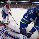 Vancouver Canucks' Kevin Bieksa, right, checks Montreal Canadiens' David Desharnais during the first period of an NHL hockey game, Thursday, Oct. 30, 2014 in Vancouver, British Columbia The Associated Press