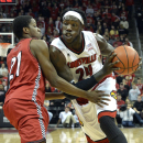 Louisville's Montrezl Harrell, right, drives to the basket through the defense of Jacksonville State's Malcolm Drumwright during the second half of an NCAA college basketball game Monday, Nov. 17, 2014, in Louisville, Ky. Louisville won 88-39. (AP Photo/Timothy D. Easley)