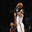Brooklyn Nets' Paul Pierce shoots a three-pointer over Toronto Raptors' Kyle Lowry (7) that put the Nets in the lead 97-94 in the second half of an NBA basketball game on Monday, March 10, 2014 at Barclays Center in New York. The Nets won 101-97 The As