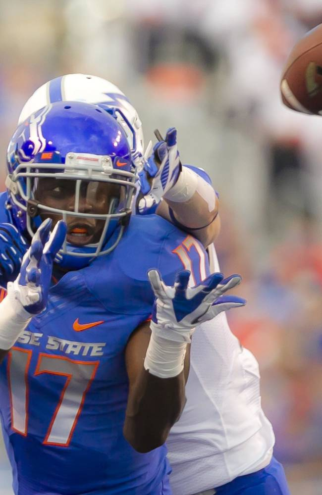 Boise State wide receiver Geraldo Boldewijn (17) is defended by Air Force defensive back Gavin McHenry during the first half of an NCAA college football game Friday, Sept. 13, 2013, in Boise, Idaho. Boise State won 42-20