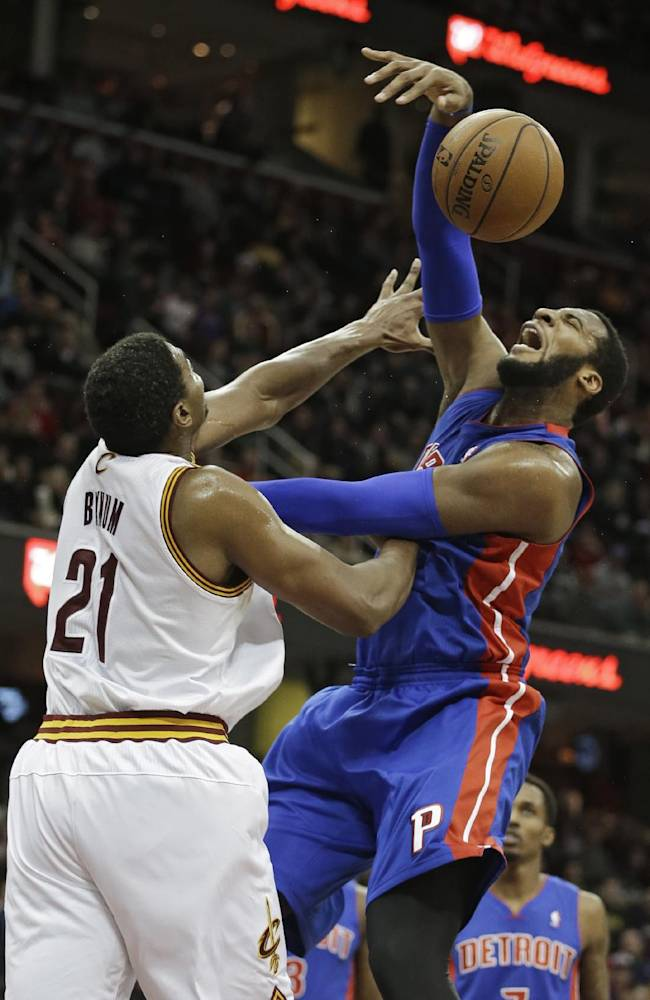 Cleveland Cavaliers' Andrew Bynum (21) fouls Detroit Pistons' Andre Drummond during the third quarter of an NBA basketball game Monday, Dec. 23, 2013, in Cleveland. The Pistons won 115-92