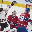 Chicago Blackhawks' Jonathan Toews (19) celebrates after scoring against Montreal Canadiens goaltender Carey Price as Canadiens' Andrei Markov (79) defends during the first period of an NHL hockey game, Tuesday, Nov. 4, 2014 in Montreal The Associated Pre