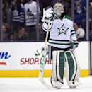 Dallas Stars goaltender Kari Lehtonen looks up at the replay after giving up the game winning overtime goal to the Toronto Maple Leafs during an NHL hockey game, Thursday, Dec. 5, 2013 in Toronto The Associated Press