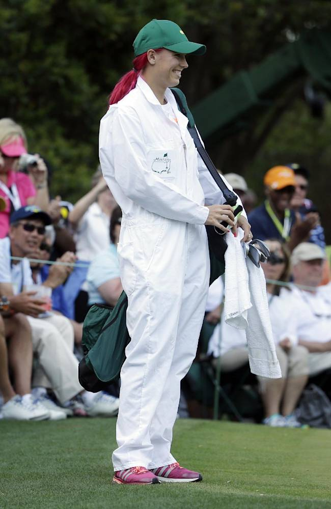 Tennis player Caroline Wozniacki waits for her fiancee Rory McIlroy, of Northern Ireland, to play during the par three competition at the Masters golf tournament Wednesday, April 9, 2014, in Augusta, Ga