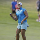 Mirim Lee of South Korea reacts after her birdie putt on the 15th hole of the final round of the Meijer LPGA Classic golf tournament at Blythefield Country Club, Sunday, Aug. 10, 2014, in Belmont, Mich. (AP Photo/Carlos Osorio)