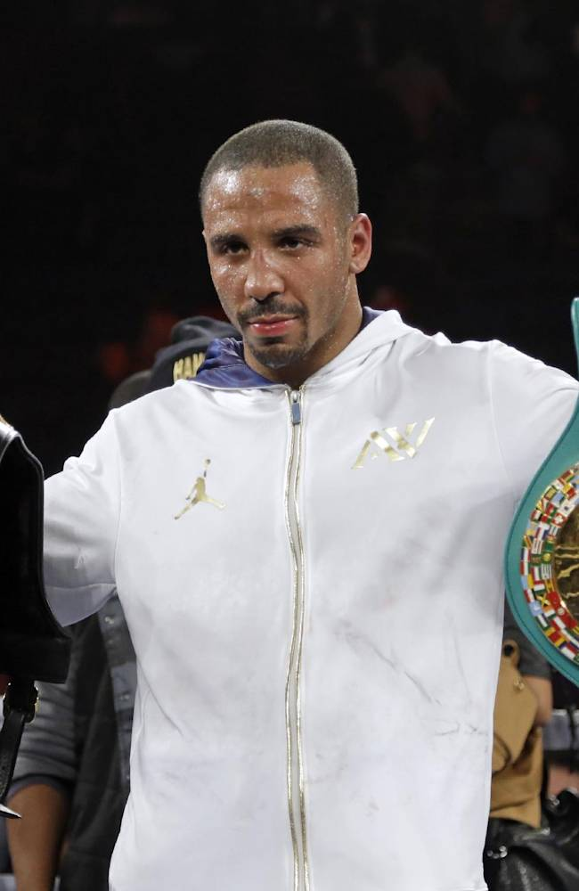 Andre Ward holds up championship belts after his defeat of Edwin Rodriguez, of the Dominican Republic, in their super middleweight championship boxing match in Ontario, Calif., Saturday, Nov. 16, 2013. Ward won by unanimous decision