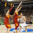 Brazil's Tiago Splitter, right, shoots over Spain's Pau Gasol, left, and Marc Gasol during the Group A Basketball World Cup match between Brazil and Spain in Granada, Spain, Monday, Sept. 1, 2014. The 2014 Basketball World Cup competition will take place in various cities in Spain from Aug. 30 through to Sept. 14. (AP Photo/Daniel Tejedor)
