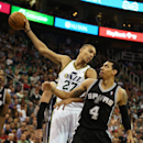 Utah Jazz's Rudy Gobert, left, holds the ball away from San Antonio Spurs' Danny Green during the second half of an NBA basketball game in Salt Lake City, Friday, Nov. 15, 2013. The Spurs won 91-82. (AP photo/George Frey) The Associated Press