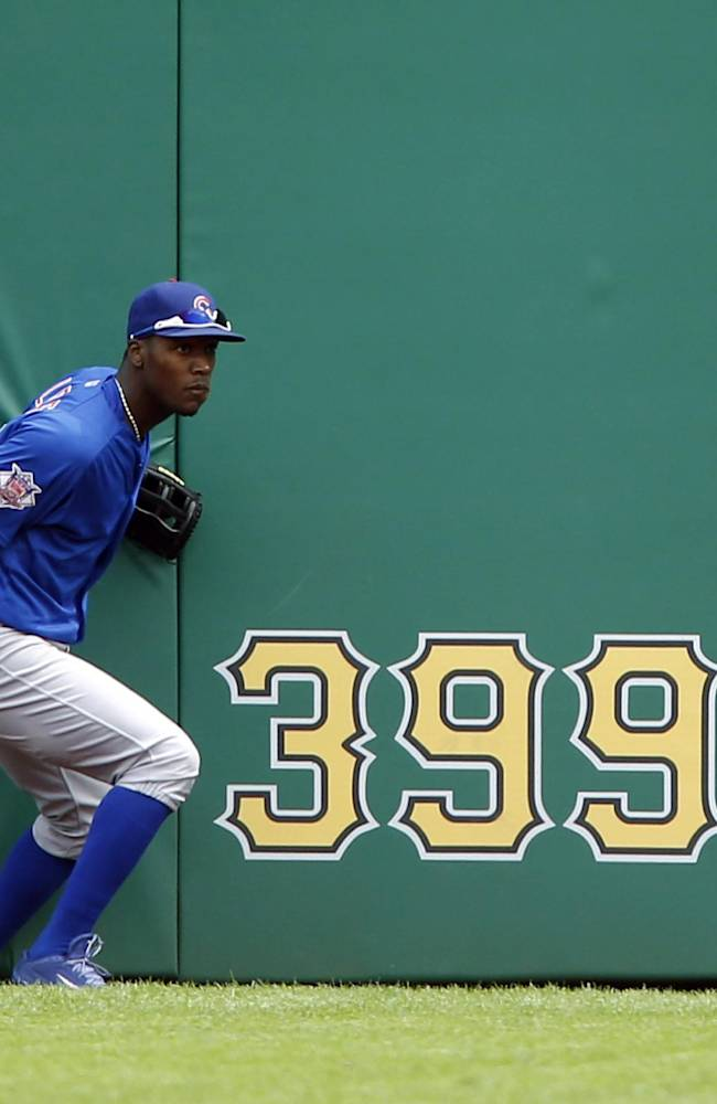Chicago Cubs left fielder Junior Lake looks for the ball hit by Pittsburgh Pirates' Jordy Mercer for a double in the first inning of the baseball game on Sunday, Sept. 15, 2013, in Pittsburgh