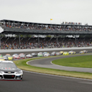 Kevin Harvick leads the field for the start of the Brickyard 400 auto race at Indianapolis Motor Speedway in Indianapolis, Sunday, July 27, 2014. (AP Photo/Tom Strattman)