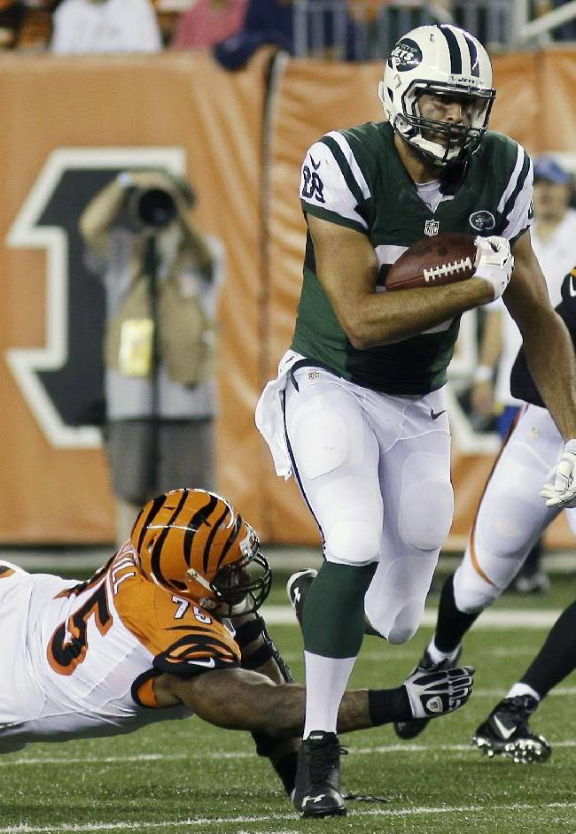 New York Jets tight end Jace Amaro (88) is pursued by Cincinnati Bengals defensive tackle Devon Still (75) in the second half of an NFL preseason football game, Saturday, Aug. 16, 2014, in Cincinnati