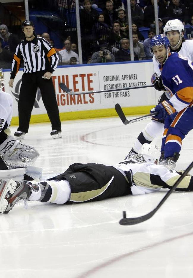 Pittsburgh Penguins goalie Jeff Zatkoff (37) stops a shot on goal by New York Islanders' Peter Regin (16) during the second period of an NHL hockey game, Thursday, Jan. 23, 2014, in Uniondale, N.Y
