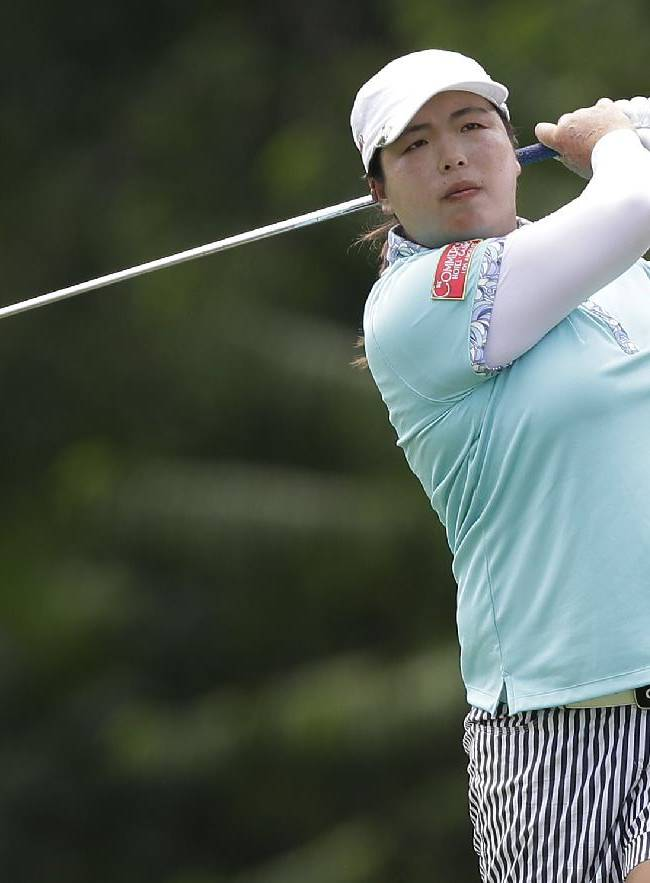 China's Shanshan Feng watches her approach during the final round at the Malaysian LGPA event in Kuala Lumpur, Sunday, Oct. 13, 2013