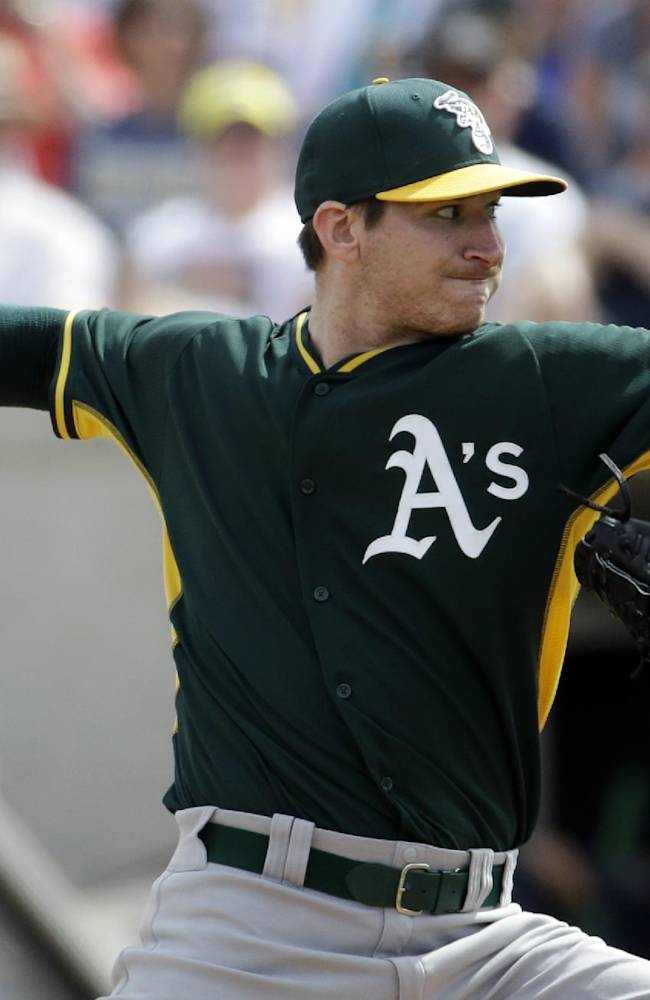 Oakland Athletics' Jarrod Parker throws during the first inning of an exhibition spring training baseball game against the Milwaukee Brewers on Wednesday, March 5, 2014, in Phoenix