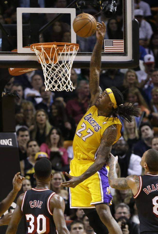 Los Angeles Lakers forward Jordan Hill (27) goes to the basket against the Miami Heat during the second quarter of an NBA basketball game in Miami, Thursday, Jan. 23, 2014