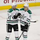 Dallas Stars right wing Erik Cole, left, celebrates with teammate Ales Hemsky (83) after scoring a goal against the Chicago Blackhawks during the third period of an NHL hockey game, Sunday, Jan. 18, 2015, in Chicago. The Stars won 6-3 The Associated Press