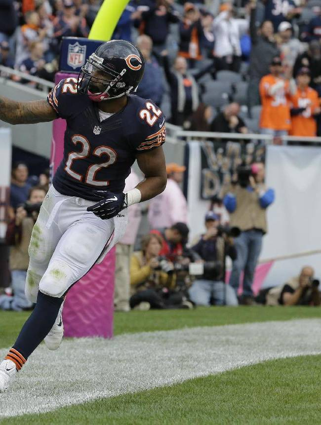 Chicago Bears running back Matt Forte (22) celebrates after making a 2-point conversion run during the second half of an NFL football game against the New Orleans Saints, Sunday, Oct. 6, 2013, in Chicago