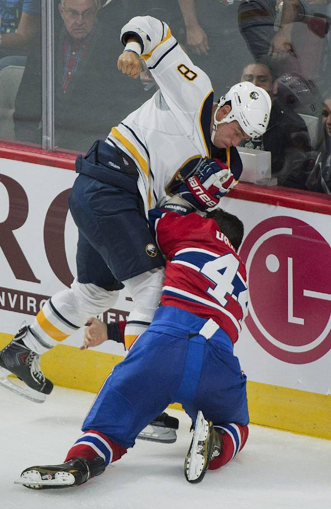 Buffalo Sabres' Cody McCormick (8) fights with Montreal Canadiens' Davis Drewiske during third period of an NHL preseason hockey game in Montreal, Sunday, Sept. 15, 2013