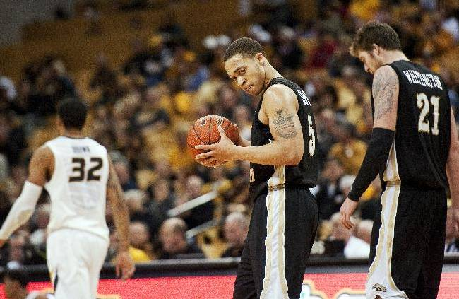 Western Michigan's David Brown, center, walks off the court in the final minute of the second half of an NCAA college basketball game with teammate Shayne Whittington, right, and Jabari Brown, left, Sunday, Dec. 15, 2013, in Columbia, Mo. Missouri won 66-60