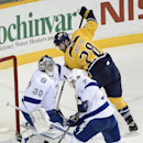 Tampa Bay Lightning goalie Ben Bishop (30) deflects a shot by Nashville Predators forward Paul Gaustad (28) as Lightning defenseman Radko Gudas (7), of Czech Republic, clears away the puck in the second period of an NHL hockey game, Thursday, Feb. 27, 201