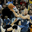 Minnesota Timberwolves' Chase Budinger (10) makes a pass that led to a score during the third quarter of an NBA basketball game against the Denver Nuggets Monday, March 3, 2014, in Denver. The Timberwolves won 132-128 The Associated Press