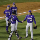 LSU pitcher Zac Person shakes hands with Michael Papierski after LSU defeated Arkansas 10-5 in a Southeastern Conference college baseball tournament game, Thursday, May 21, 2015, in Hoover, Ala. (AP Photo/Brynn Anderson)