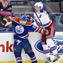 New York Rangers Anton Stralman (6) is checked by Edmonton Oilers Sam Gagner (89) during third period NHL hockey action in Edmonton, Alberta, on Sunday March 30, 2014 The Associated Press