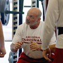 Arizona Cardinals strength and conditioning coach Buddy Morris works on weightlifting with Cardinals offensive linemen during the first phase of the voluntary offseason training program at the NFL football team's training facility on Thursday, April 24, 2