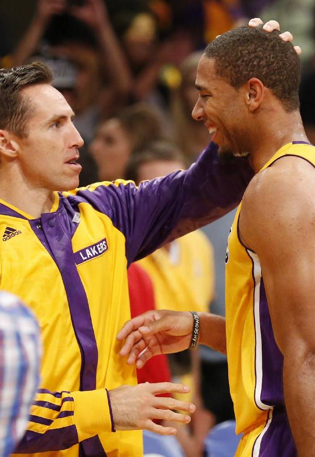 Los Angeles Lakers' Xavier Henry, right, is congratulated by Steve Nash after the Lakers defeated the Los Angeles Clippers 116-103 in an NBA basketball game in Los Angeles, Tuesday, Oct. 29, 2013