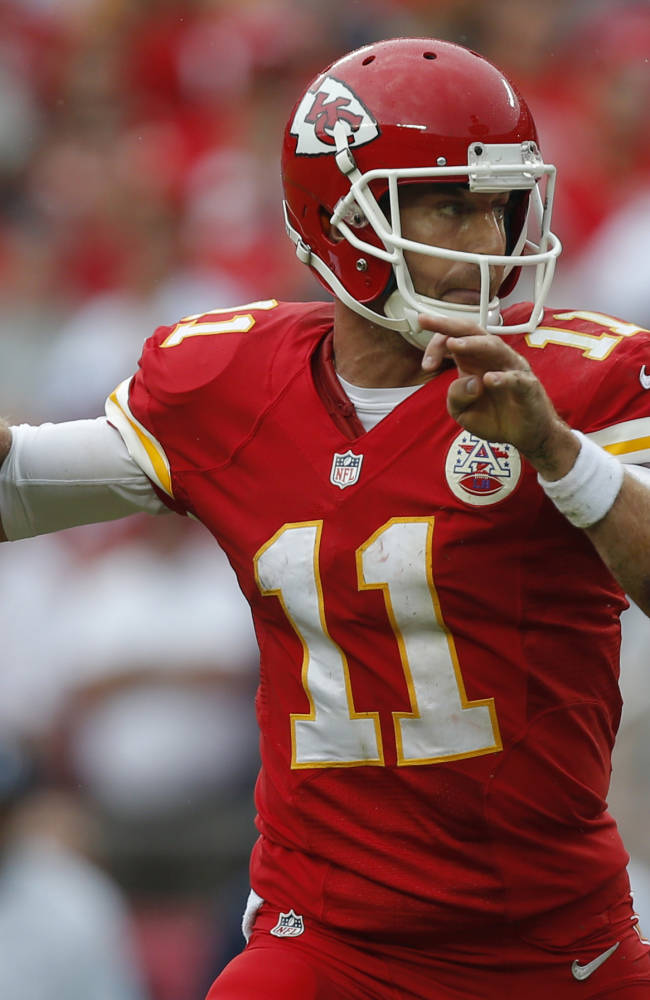 Kansas City Chiefs quarterback Alex Smith (11) throws a pass during the first half of an NFL football game against the Dallas Cowboys at Arrowhead Stadium in Kansas City, Mo., Sunday, Sept. 15, 2013