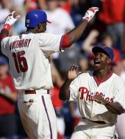 Philadelphia Phillies' John Mayberry Jr., left, and Juan Pierre celebrate after Mayberry's game-winning RBI single in the ninth inning of the first game of a baseball doubleheader against the Colorado Rockies, Sunday, Sept. 9, 2012, in Philadelphia. Philadelphia won 3-2. (AP Photo/Matt Slocum)
