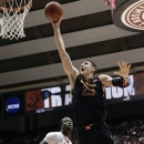 Maryland center Alex Len (25) shoots in front of Alabama center Moussa Gueye (14) during the first half of an NIT college basketball game in Tuscaloosa, Ala., Tuesday, March 26, 2013. (AP Photo/Dave Martin)