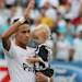 Santos' Neymar  holds his son Davi Lucca prior to the final match of the Sao Paulo Dtate soccer league against Corinthians in Santos, Brazil, Sunday, May 19, 2013. Corinthians won 3-2 on aggregate and wins the Sao Paulo State championship