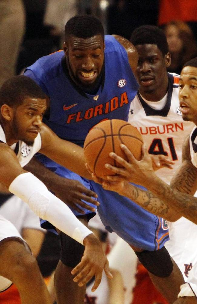 Auburn guard Chris Densen, right, steals the ball as Auburn guard KT Harrell (1) and Florida center Patric Young, second from left, and Auburn center Matthew Atewe (41) pursue during second-half action of an NCAA college basketball game  in Auburn, Ala., Saturday, Jan. 18, 2014