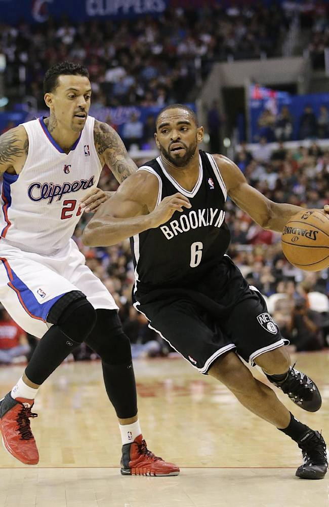 Brooklyn Nets' Alan Anderson, right, drives past Los Angeles Clippers' Matt Barnes during the second half of an NBA basketball game on Saturday, Nov. 16, 2013, in Los Angeles
