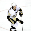 Pittsburgh Penguins defenseman Kris Letang (58) skates with the puck in the third period during an NHL hockey game against the Dallas Stars, Saturday, Jan. 25, 2014, in Dallas The Associated Press