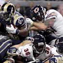 St. Louis Rams running back Zac Stacy (30) scores on a 1-yard run as Chicago Bears safety Chris Conte, top right, and cornerback Zack Bowman (38) defend during the first quarter of an NFL football game on Sunday, Nov. 24, 2013, in St. Louis The Associated