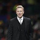 Manchester United's manager David Moyes walks from the pitch after the end of their Champions League group A soccer match between Manchester United and Shakhtar Donetsk at Old Trafford Stadium, Manchester, England, Tuesday, Dec. 10, 2013. United won the g
