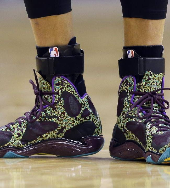 Golden State Warriors' Stephen Curry shoes a seen during the first half of an NBA basketball game against the Indiana Pacers Tuesday, March 4, 2014, in Indianapolis