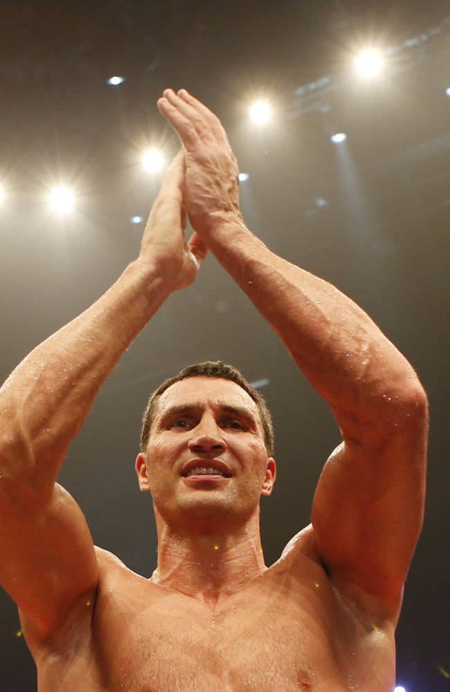 IBF, WBA, WBO and IBO champion Wladimir Klitschko from Ukraine celebrates winning the heavyweight world title bout against his Australian challenger Alex Leapai in Oberhausen, western Germany, Saturday, April 26, 2014