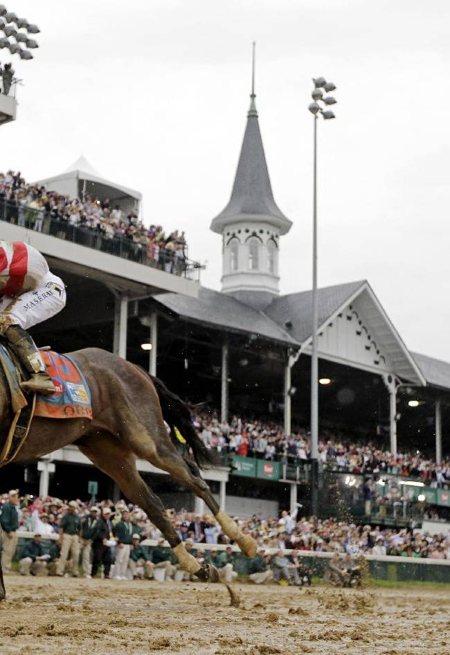 In this May 4, 2013 file photo, Joel Rosario rides Orb, left, to victory in the 139th Kentucky Derby at Churchill Downs  in Louisville, Ky. A full field of 20 is expected for the 140th Kentucky Derby on May 3, 2014