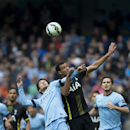 Manchester City's David Silva, left, fights for the ball against Tottenham's Etienne Capoue during the English Premier soccer match between Manchester City and Tottenham Hotspur at the Etihad Stadium, Manchester, England, Saturday Oct. 18, 2014