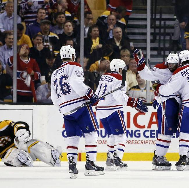 Montreal Canadiens left wing Max Pacioretty (67) celebrates his goal with defenseman P.K. Subban (76) and other teammates, against Boston Bruins goalie Tuukka Rask, left, during the second period in Game 7 of an NHL hockey second-round playoff series in Boston, Wednesday, May 14, 2014