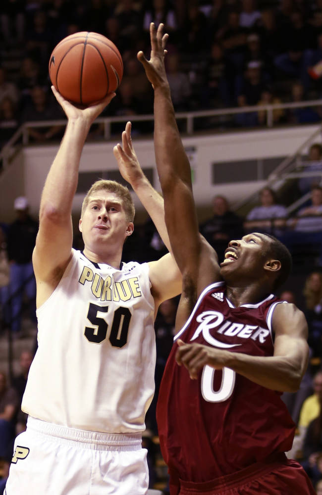 Purdue forward Travis Carrol (50) shoots the basketball over Rider forward Kahlil Thomas in the first half of an NCAA basketball game in West Lafayette, Ind., Sunday, Nov. 17, 2013