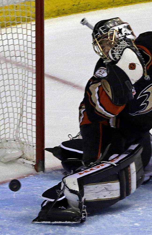 Anaheim Ducks goalie Jonas Hiller, of Switzerland, defects a shot by the Detroit Red Wings in the third period of an NHL hockey game in Anaheim, Calif., Sunday, Jan. 12, 2014. The Ducks won 1-0