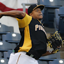 Pittsburgh Pirates pitcher Edinson Volquez throws long toss in the outfield during a team workout in Pittsburgh on Tuesday, Sept. 30, 2014. Volquez gets the start against the San Francisco Giants in Wednesday's National League baseball wild card game in Pittsburgh. (AP Photo/Gene J. Puskar)
